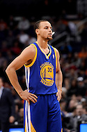 Dec 15, 2013; Phoenix, AZ, USA; Golden State Warriors guard Stephen Curry (30) stands on the court against the Phoenix Suns in the first half at US Airways Center. The Suns defeated the Warriors 106-102. Mandatory Credit: Jennifer Stewart-USA TODAY Sports