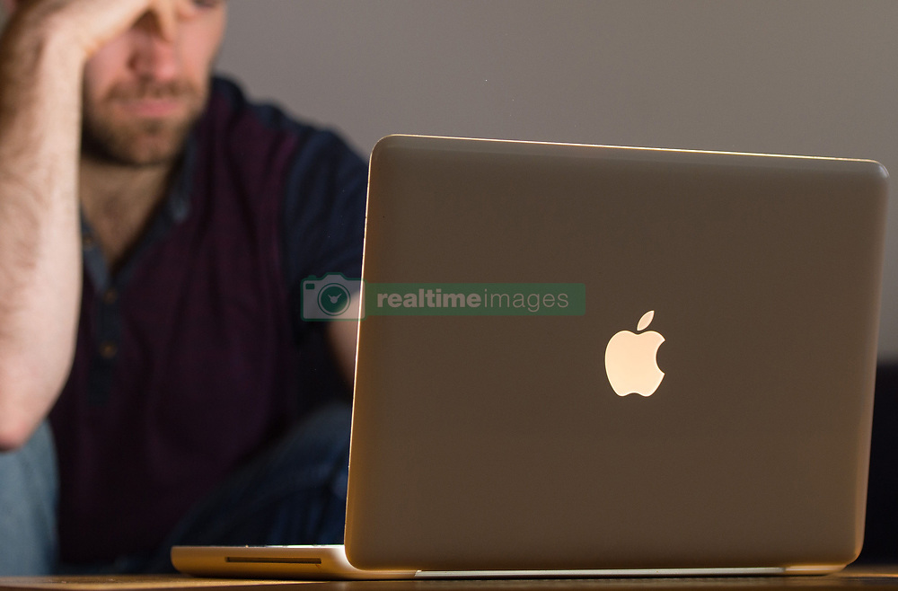 PICTURE POSED BY MODEL File photo dated 09/03/15 of a man using a laptop. A Royal Society for Public Health (RSPH poll suggests that four in five people support tighter regulation of social media platforms to reduce perceived negative impact on issues like depression, anxiety, and lack of sleep.