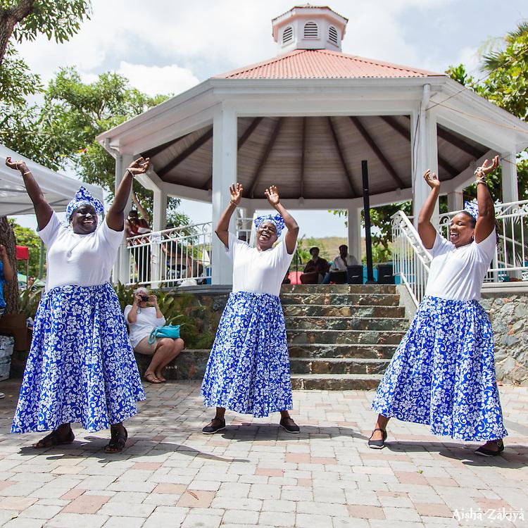"(L-R) Latoya Edwards, Jennifer Toussaint, and Allegra Christopher, of the Macislyn Bamboula Dance Company dance the Bamboula.  Emancipation Celebration 2015 in tribute to Oswin ""Zeke"" Sewer, Sr.  at Frank A. Powell, Sr. Park.  St. John, US Virgin Islands.  3 July 2015.  © Aisha-Zakiya Boyd"
