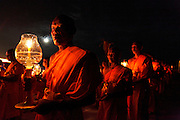 28th February 2010 - Pathum Thani, Thailand - The annual celebration of Mucha Bucha Day, a Buddhist festival, where over 40,000 monks and lay people meditated and lit candles. Photo credit: Luke Duggleby