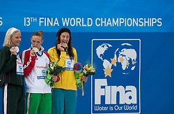 Kirsty Coventry of Zimbabwe (L) celebrates the silver medal, Katinka Hosszu of Hungary (C) the gold medal and Stephanie Rice of Australia the bronze medal during the medal ceremony for the Women's 400m Individual Medley Final at the 13th FINA World Championships Roma 2009, on August 2, 2009, at the Stadio del Nuoto,  in Foro Italico, Rome, Italy. (Photo by Vid Ponikvar / Sportida)