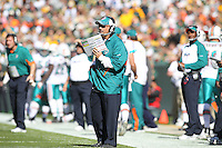 GREEN BAY, WI - OCTOBER 17: Head coach Tony Sparano of the Miami Dolphins calls in a play during the game against the Green Bay Packers at Lambeau Field on October 17, 2010 in Green Bay, Wisconsin. The Dolphins defeated the Packers 23-20 in overtime. (Photo by Tom Hauck) Player:Tony Sparano