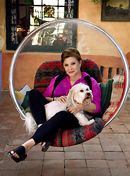CARRIE FRANCES FISHER (October 21, 1956 – December 27, 2016) the actress best known as Star Wars' Princess Leia Organa, has died after suffering a heart attack. She was 60. Pictured: October 9, 2012 - Beverly Hills, CA, USA - Actress Carrie Fisher poses during an interview at her home in Coldwater Canyon in 2012. (Credit Image: © Leonard Ortiz/The Orange County Register via ZUMA Wire)
