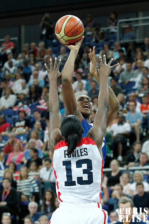 11 August 2012: France Sandrine Gruda takes a jumpshot over Sylvia Fowles during 86-50 Team USA victory over Team France, during the Women's Gold Medal Game, at the North Greenwich Arena, in London, Great Britain.