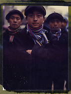 Polaroid 79 portrait of three ethnic minority men in Ha Giang Province wearing traditional clothing, Northern Vietnam, Southeast Asia