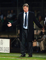 Photo: Daniel Hambury.<br />Lyon v PSV Eindhoven. UEFA Champions League. 08/03/2006.<br />PSV's coach Guus Hiddink looks upset as his side concede two first half goals.