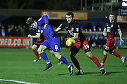 AFC Wimbledon midfielder Jake Reeves (8) and Coventry City defender Farrend Rawson (19) during the EFL Sky Bet League 1 match between AFC Wimbledon and Coventry City at the Cherry Red Records Stadium, Kingston, England on 14 February 2017. Photo by Stuart Butcher.