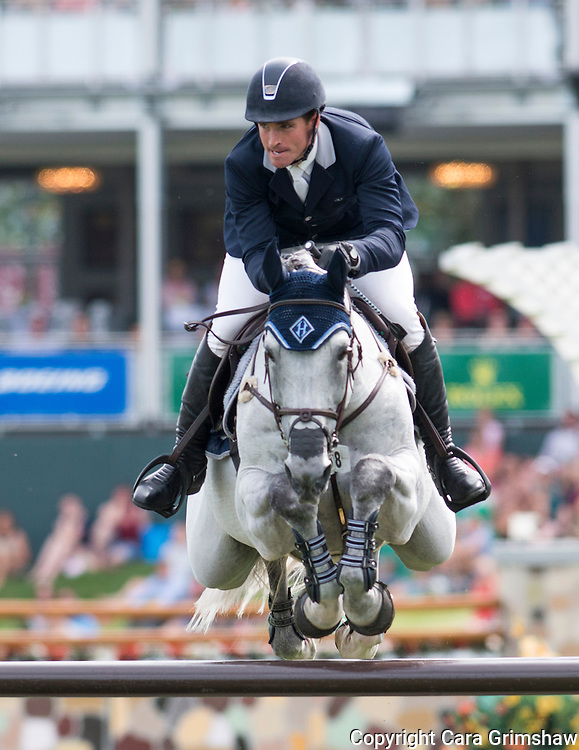 QUENTIN JUDGE (USA) rides HH DARK DE LA HART in the 1.50m Derby Nexen Cup during National CSI 5* at Spruce Meadows presented by Rolex, June 7 2015. Calgary.