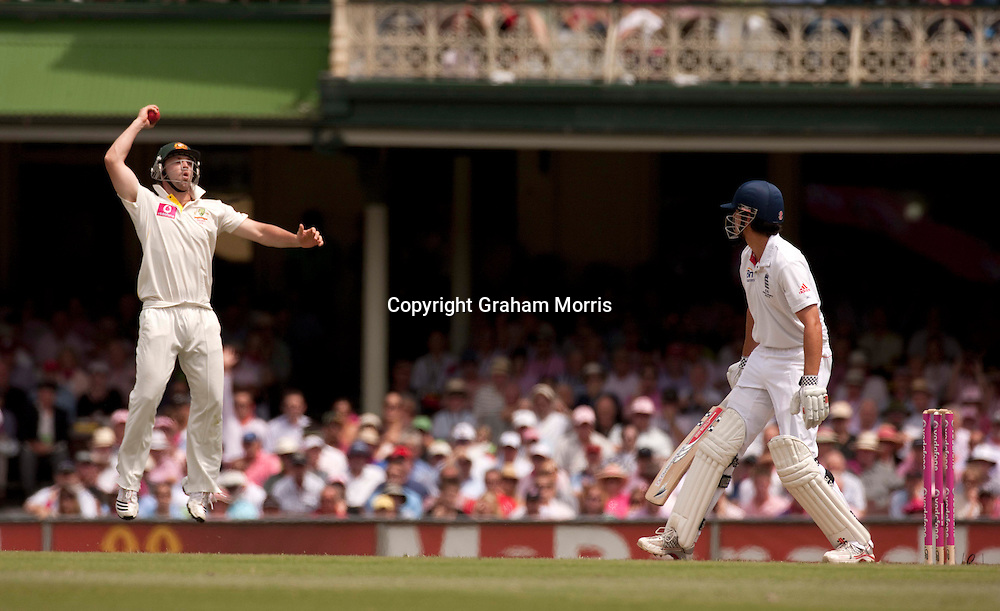 Close fielder Phillip Hughes claims the catch of Alastair Cook (not out) during his century in the fifth and final Ashes test match between Australia and England at the SCG in Sydney, Australia. Photo: Graham Morris (Tel: +44(0)20 8969 4192 Email: sales@cricketpix.com) 05/01/11