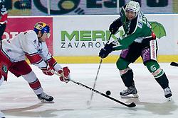 Petr Sachl (HDD Tilia Olimpija, #12) during ice-hockey match between HDD Tilia Olimpija and EC Red Bull Salzburg in 29th Round of EBEL league, on December 23, 2010 at Hala Tivoli, Ljubljana, Slovenia. (Photo By Matic Klansek Velej / Sportida.com)
