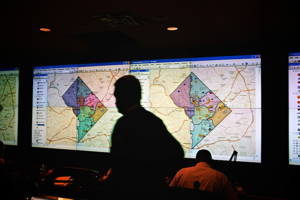 DC police commander Andy Solberg walks to his seat at the Joint Operation Command Center in Metropolitan Police Station Headquarters in DC. In the morning meetings, commander Solberg and the other six district commanders review all of the crime that occurred over the weekend.