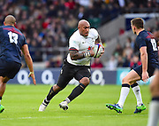 Fijian Nemani Nadolo on the attack in the first half during the Autumn International Series match between England and Fiji at Twickenham, Richmond, United Kingdom on 19 November 2016. Photo by Ian  Muir.