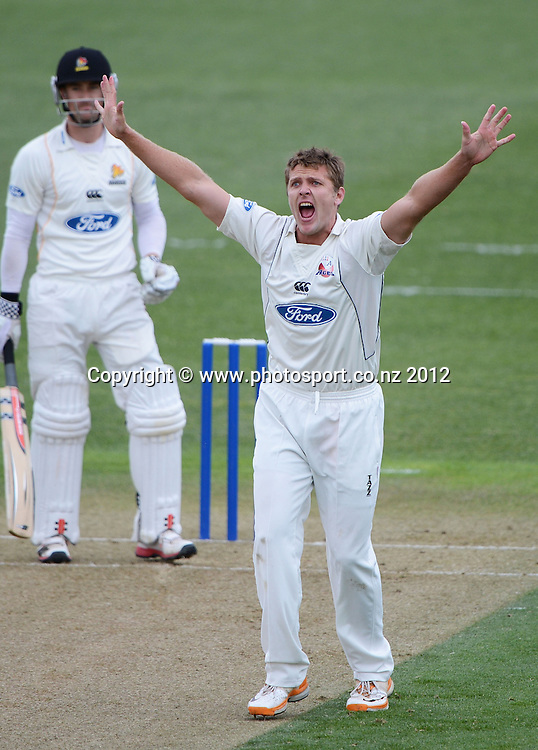 Auckland bowler Michael Bates appeals successfully for a LBW decision to dismiss Wellington's Josh Brodie. Plunket Shield Cricket, Auckland Aces v Wellington Firebirds at Eden Park Outer Oval. Auckland on Monday 26 November 2012. Photo: Andrew Cornaga/Photosport.co.nz