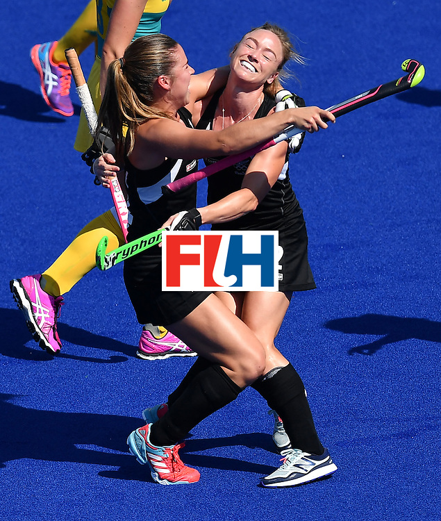 New Zealand's Anita McLaren (R) celebrates the opening goal during the the women's quarterfinal field hockey New Zealand vs Australia match of the Rio 2016 Olympics Games at the Olympic Hockey Centre in Rio de Janeiro on August 15, 2016. / AFP / MANAN VATSYAYANA        (Photo credit should read MANAN VATSYAYANA/AFP/Getty Images)