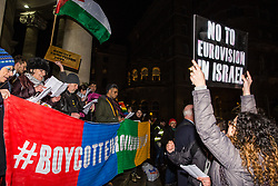 London, UK. 8th February, 2019. Pro-Palestinian activists sing during a 'Love Eurovision, Hate Apartheid!' protest outside BBC Broadcasting House organised by London Palestine Action to call on the BBC to withdraw from the 2019 Eurovision Song Contest hosted by Israel so as to avoid complicity in 'artwashing' Israel's violations of Palestinian human rights. The protest formed part of a global campaign to Boycott Eurovision in Israel.