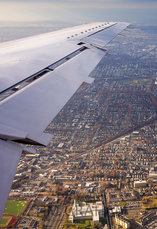 Aerial view from window of a jet aircraft flying into New York, USA