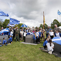 "THe Earl of Moray, pictured between the plinths on the left is Andrew de Moray's direct descendent and unveils the lecterns with the help of the local children from St Ninians Primary School.<br /> <br /> BRAVEHEART HEROES, WILLIAM WALLACE AND ANDREW DE MORAY, FINALLY HONOURED AT STIRLING BRIDGE BATTLE SITE AS SALTIRE RAISED FOR FIRST TIME IN OVER 700 YEARS<br /> <br /> Friday 29th May, 2015<br /> <br /> IT'S TAKEN more than 700 years but today, the two heroes at the centre of one of the most important battles in Scottish history have been jointly honoured at the spot where they both led an outnumbered Scottish army to victory against the English.<br /> The formal unveiling ceremony at Stirling Bridge today (Friday 29th May), of three lecterns made of traditional Scottish whinstone dedicated to the memory of William Wallace and Andrew de Moray, at site of the historic victory at Battle of Stirling Bridge.<br /> At a special ceremony attended by Andrew de Moray's direct descendant, the Earl of Moray, and Stewart Maxwell, MSP, convener of the Scottish Parliament's Education and Culture Committee, the memorials were formally unveiled.Mr Maxwell opened the event and after the dedication, together with the Earl of Moray, they raised the Saltire together at the site of the Battle of Stirling Bridge. This is the first time in over 700 years that the Saltire has flown at Stirling Bridge. The flag will now become a permanent fixture at the site of the Battle.<br /> John Stuart, the current Earl of Moray, said of his illustrious kinsman: ""I am delighted that Andrew de Moray is finally, after 700 years, to have the recognition he deserves. The Guardians of Scotland have put a huge amount of time and effort into the lecterns, which are a very fitting tribute to one of Scotland's greatest patriots.""<br /> The victory represented a key moment in the Scottish Wars of Independence. Eminent Scots historian, Sir Tom Devine, recently described the battle as being 'second in importance only to Bannockburn in the Wars of Independenc"