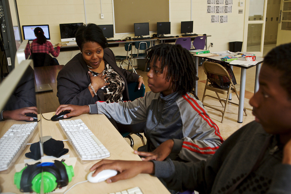 D.C. Public Schools Chancellor Kaya Henderson talks to eighth-graders Marquise Harris, center, and Octavious Beasley about what high schools they are going to attend at Truesdell Education Campus on Friday, Nov. 16, 2012 in Washington, D.C. Henderson recently announced that she plans to close 20 under-enrolled schools across the district. CREDIT: Lexey Swall for The Wall Street Journal