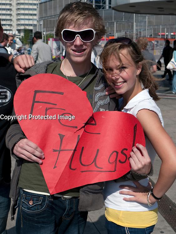 Two American teenager Christians offering Free Hugs in Alexanderplatz in Mitte Berlin Germany