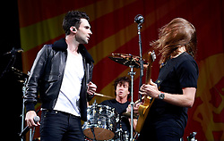 03 May 2013. New Orleans, Louisiana,  USA. .New Orleans Jazz and Heritage Festival. Maroon 5..Adam Levine and James Valentine rock JazzFest to the delight of the mud spattered crowd. .Photo; Charlie Varley.