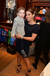 LILY HODGES and her son JONATHAN HODGES at the 4th birthday party for Amadeus Becker, son of Boris & Lilly Becker held at Ralph Lauren, 143 New Bond Street, London on 9th February 2014.