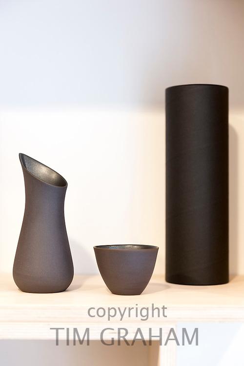 Minimallst design ceramics by designer craftsman Ditte Fischer in shop in Laederstraede, Copenhagen, Denmark - vase, jug, bowl
