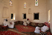 SAUDI ARABIA: Najran.Saudis relaxing inside the Palace of Ibn Madi, now a museum.