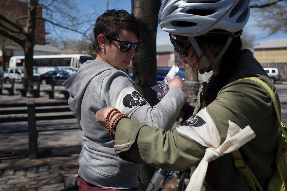 Families and friends of New Yorkers killed while bicycling on New York City streets gather at Seth Low Square in Brooklyn, NY, on Sunday, April 21, 2013 as they participate in the 8th Annual Ghost Bike Memorial Ride. The ride visited the 20 white-painted Ghost Bikes installed at the scene of bicyclist fatalities in five boroughs before converging at the intersection of Queens Boulevard and Jackson Avenue to dedicate a memorial to all of the cyclists who were killed in traffic crashes in 2012 whose deaths did not make the news...According to the New York City Department of Transportation, 136 pedestrians and 18 bicyclists were killed in 2012. In 2011, 134 pedestrians and 22 bicyclists were killed on New York City streets. To date, at least two bicyclists have been killed in 2013...Photograph by Andrew Hinderaker for the Ghost Bike Project.