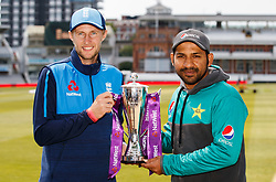 England's captain Joe Root, (left) and Pakistan captain Sarfraz Ahmed pose with the trophy at Lord's, London.
