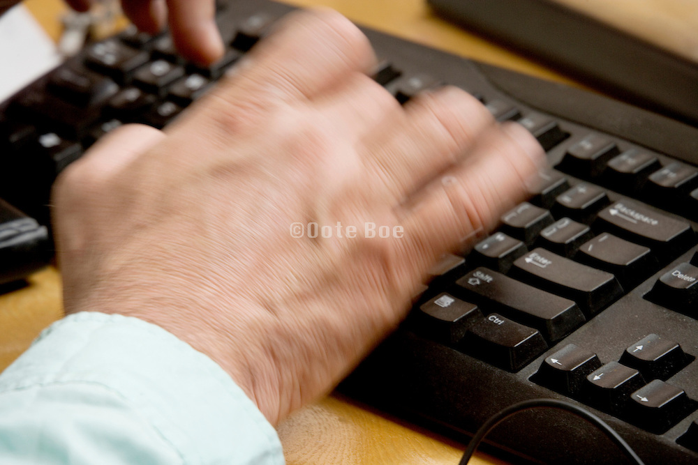 hands of a male person typing
