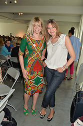Left to right, JO WOOD and CATH KIDSTON at a lunch in aid of the charity African Solutions to African Problems (ASAP) held at the Louise T Blouin Foundation, 3 Olaf Street, London W11 on 21st May 2014.
