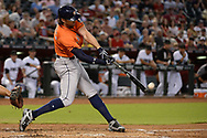 PHOENIX, AZ - AUGUST 15:  Jake Marisnick #6 of the Houston Astros singles on a fly ball in the second inning against the Arizona Diamondbacks at Chase Field on August 15, 2017 in Phoenix, Arizona.  (Photo by Jennifer Stewart/Getty Images)