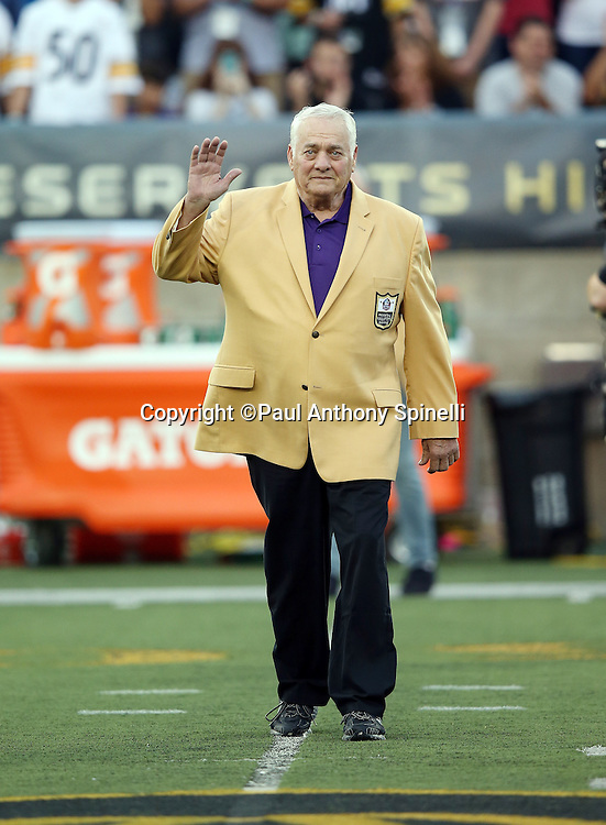 Former Minnesota Vikings center Mick Tingelhoff waves as he is introduced as a newly enshrined member of the NFL Pro Football Hall of Fame before the Pittsburgh Steelers 2015 NFL Pro Football Hall of Fame preseason football game against the Minnesota Vikings on Sunday, Aug. 9, 2015 in Canton, Ohio. The Vikings won the game 14-3. (©Paul Anthony Spinelli)