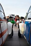 two classic Citroen 2CV cars watching people dance