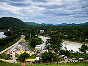09 AUGUST 2018 - KAENG KRACHAN, PHETCHABURI, THAILAND: The generating station below the Kaeng Krachan Dam. The Phetchaburi River flows from Kaeng Krachan Dam to the Gulf of Siam through several towns including Ban Lat, Phetchaburi (the capital of Phetchaburi province) and Ban Laem. Government officials have warned residents of those towns that their towns will flood because the reservoir behind the dam is approaching capacity. Ban Lat and Phetchaburi could be flooded for several weeks. Residents of Ban Laem have been warned that their community could be inundated for over a month. Dams in Kanchanaburi province, west of Phetchaburi, are also approaching capacity and flooding is also expected in that area.   PHOTO BY JACK KURTZ