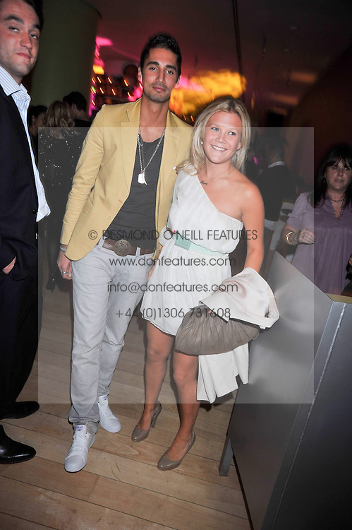 HUGO TAYLOR and  OLIVIA 'BUBBLE' PERRY at the St.Martins Lane Hotel 10th year bash held on 9th September 2009.
