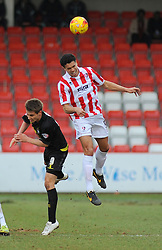 Cheltenham Town's Troy Brown and Bury's Danny Rose challenge for the ball in mid-air - Photo mandatory by-line: Nizaam Jones - Mobile: 07966 386802 - 14/02/2015 - SPORT - Football - Cheltenham - Whaddon Road - Cheltenham Town v Bury - Sky Bet League Two
