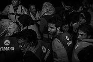 An inflatable boat overcrowded with Syrian refugees had it's engine failure during the night trip from Turkish coast, but was safely  spotted and towed to Skala Sikaminias port by a Greek fishing boat, Lesbos, Greece on 12 November, 2015. At the port, refugees are told to calmly disembark, children first. Lesbos, the Greek vacation island in the Aegean Sea between Turkey and Greece, faces massive refugee flows from the Middle East countries.