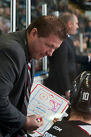 KELOWNA, CANADA - FEBRUARY 10: Vancouver Giants' head coach Jason McKee draws a play on the coaches board on the bench against the Kelowna Rockets on February 10, 2017 at Prospera Place in Kelowna, British Columbia, Canada.  (Photo by Marissa Baecker/Shoot the Breeze)  *** Local Caption ***