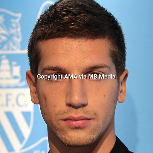 Matija Nastasic posing in the Manchester City 2013/14 Away Kit at a mall in Hong Kong.