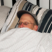 Jim Fox sleeps off his rest day. United Finance (formerly Finnegan's Toys / Discover Chiropractic) Cycling Team winter training camp, January 30 to February 5, 2010; Palm Springs, California.  Emerald Velo Cycling Club (EVCC).