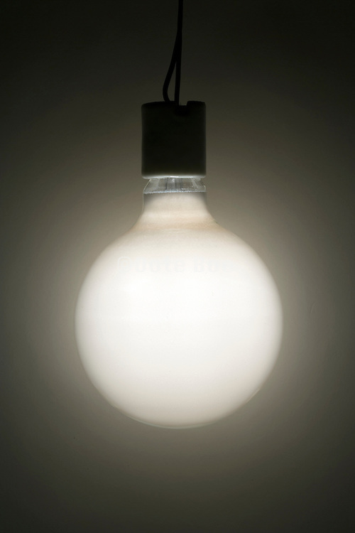 an illuminated round light bulb