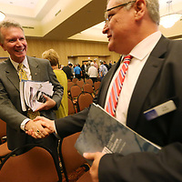 Mike Staten, left, gets congraulated after winning this year's Jack Reed Sr. Community Leadership Award at the annual CREATE State of the Region meeting at the BancorpSouth Conference Center Thursday.