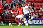 Bolton Wanderers striker Jamie Proctor (9) battles for possession with Charlton Athletic defender Ezri Konsa (15) during the EFL Sky Bet Championship match between Charlton Athletic and Bolton Wanderers at The Valley, London, England on 27 August 2016. Photo by Matthew Redman.