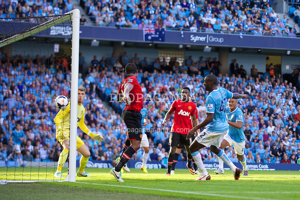MANCHESTER, ENGLAND - Sunday, September 22, 2013: Manchester City's Yaya Toure scores the second goal against in added time of the first half against Manchester United during the Premiership match at the City of Manchester Stadium. (Pic by David Rawcliffe/Propaganda)