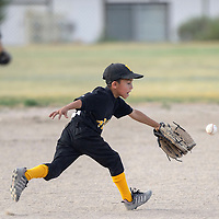 070114  Adron Gardner/Independent<br /> <br /> Pirate Evan Jimenez (8) chases a Red Sox ground ball during the Roberto Clemente championship game at Father Dunston Park in Gallup Tuesday.