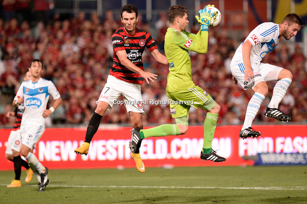 06.01.2015. Sydney, Australia. Hyundai A-League Round 14. Western Sydney Wanderers FC v Melbourne Victory FC. Wanderers forward Labinot Haliti  and Victory goalkeeper Nathan Coe.Victory won the game 2-1.