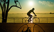 Silhoutte of Cyclist against Sunrise at Singapore Changi Beach