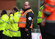 Stewards keep an eye on the Oxford fans in the away end during the Sky Bet League 2 match between Leyton Orient and Oxford United at the Matchroom Stadium, London, England on 17 October 2015. Photo by Bennett Dean.