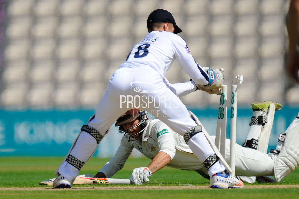 Surrey's Ben Foakes dives for his crease to prevent himself being run out during the Specsavers County Champ Div 1 match between Hampshire County Cricket Club and Surrey County Cricket Club at the Ageas Bowl, Southampton, United Kingdom on 18 July 2016. Photo by Graham Hunt.